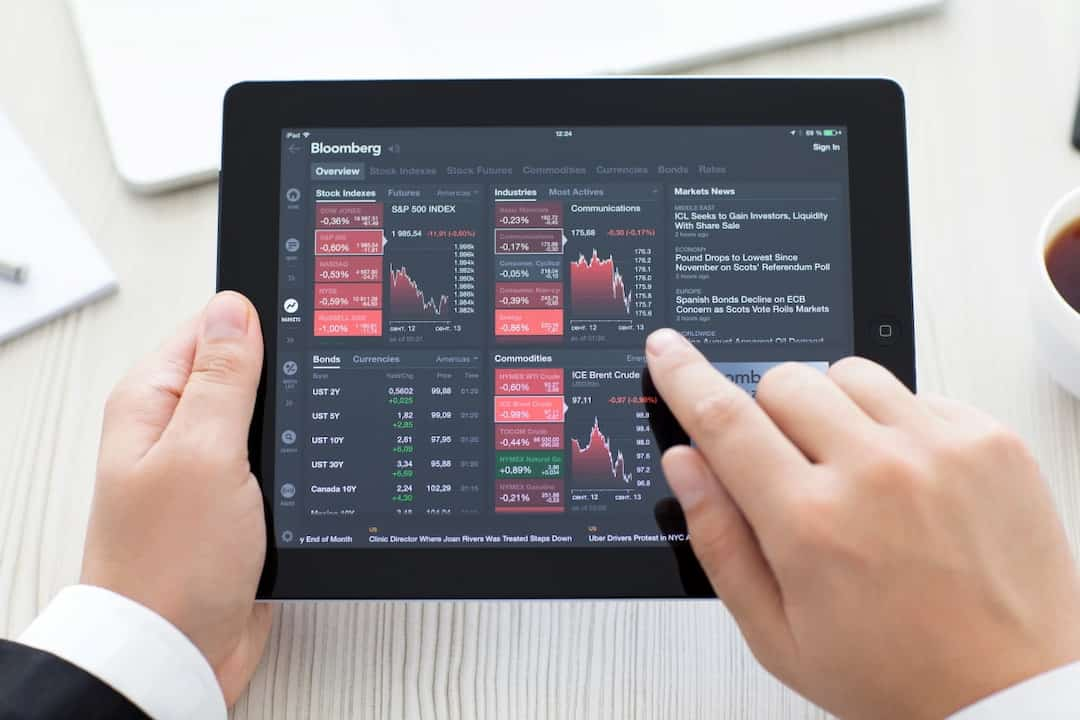a person using Bloomberg app on tablet