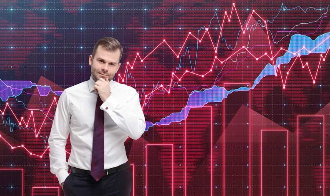 a trader standing in front of the forex graph