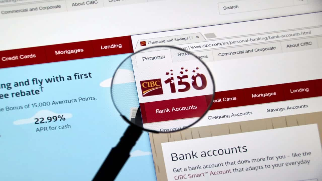 exploring CIBC web page with magnifying glass