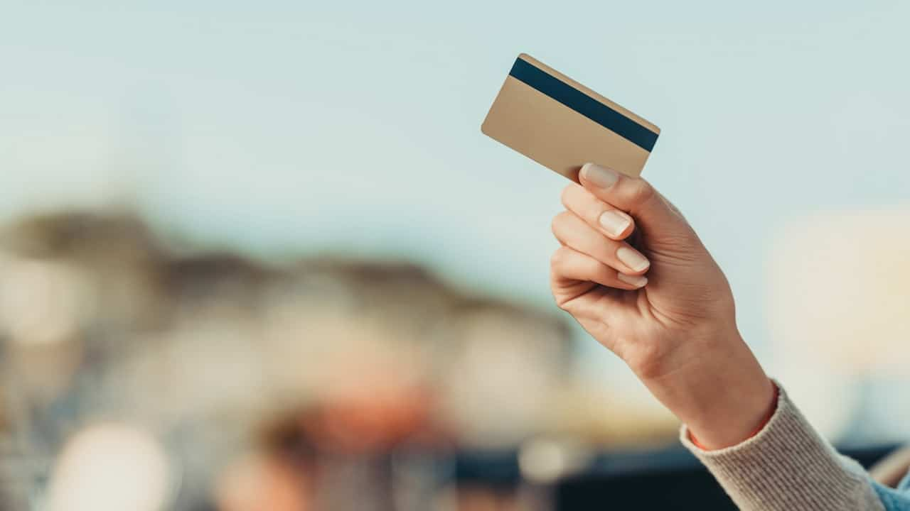 a woman holding credit card in her hand