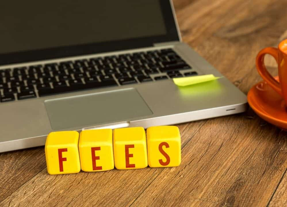 laptop and word FEES on the table