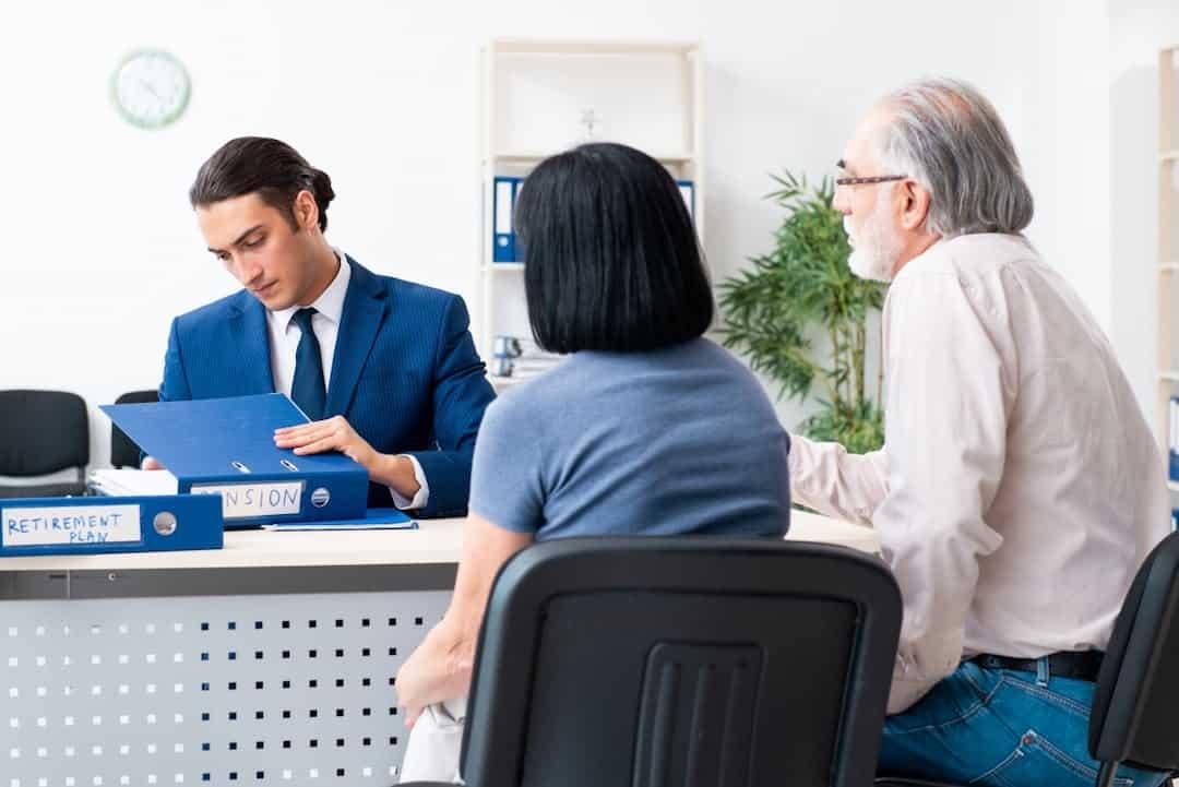 Financial advisor giving retirement advice to the senior couple