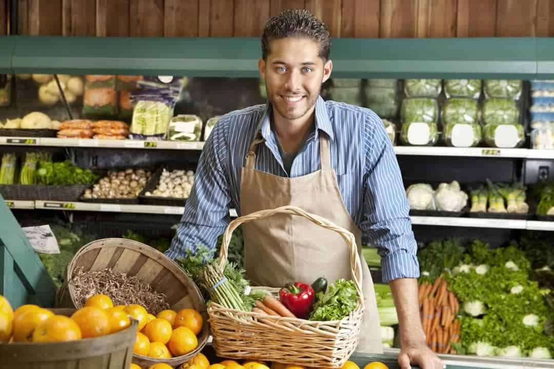 a smiling salesman in the groceries store