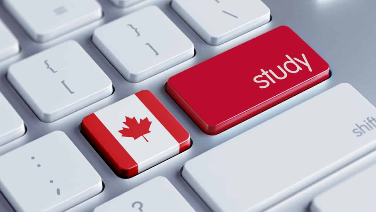 Key STUDY and the flag of Canada on the keyboard