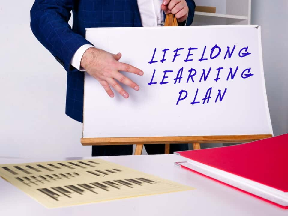 a person showing the panel with Lifelong Learning Plan