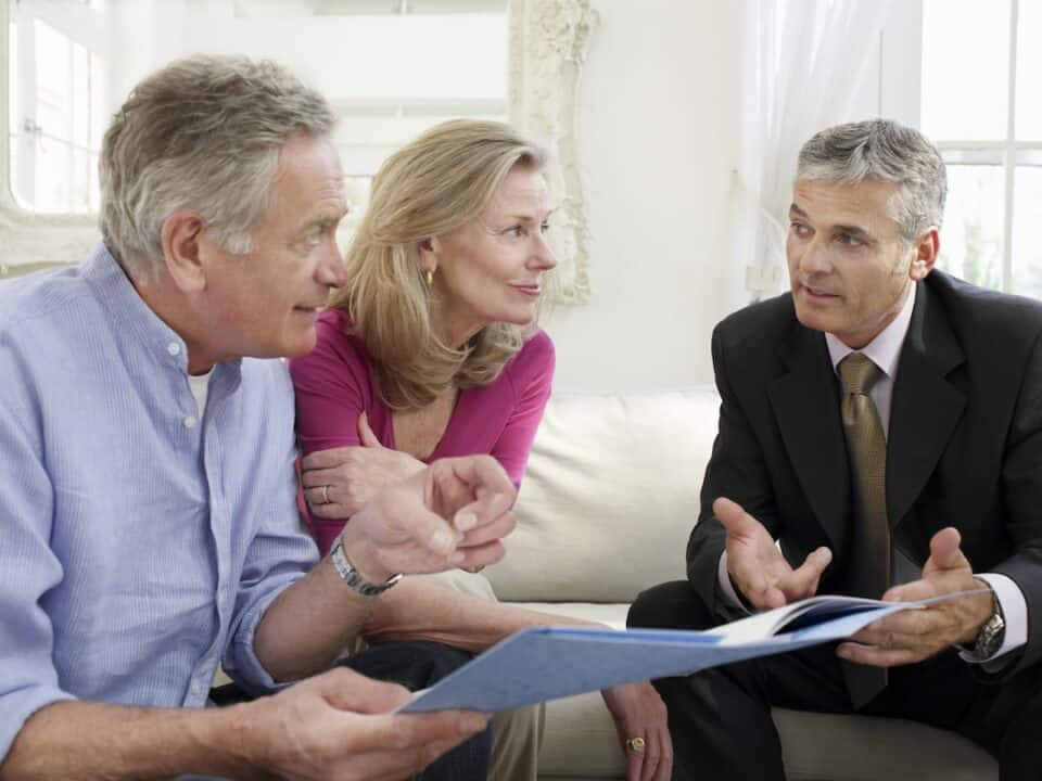 a senior couple with financial advisor