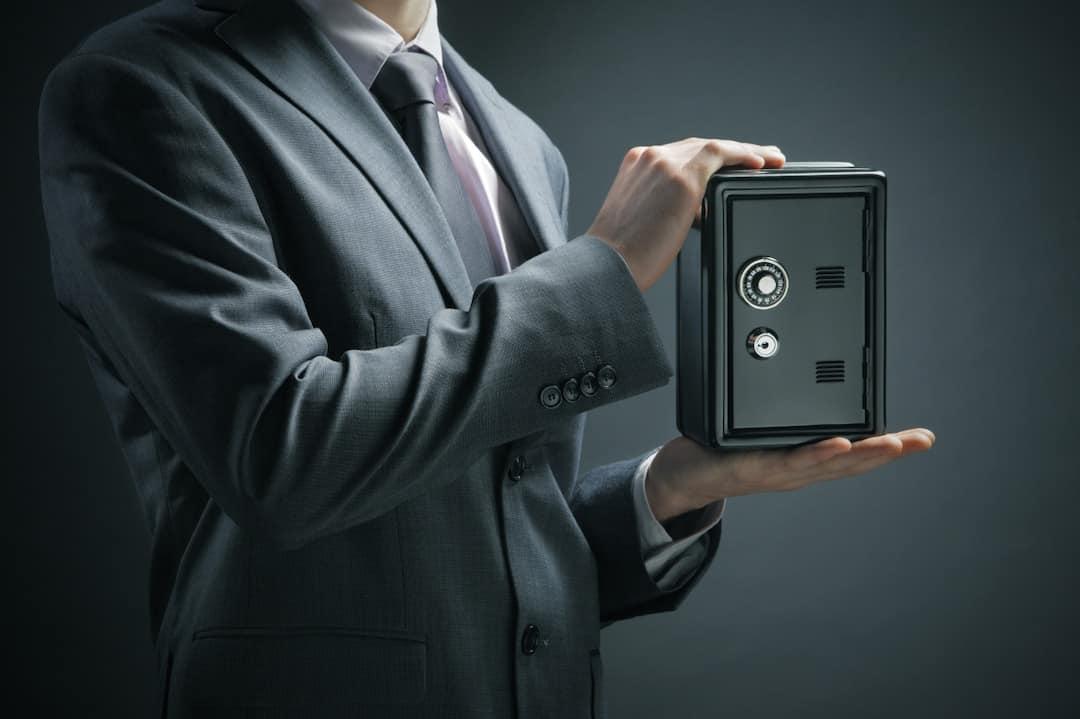 a man holding a safe