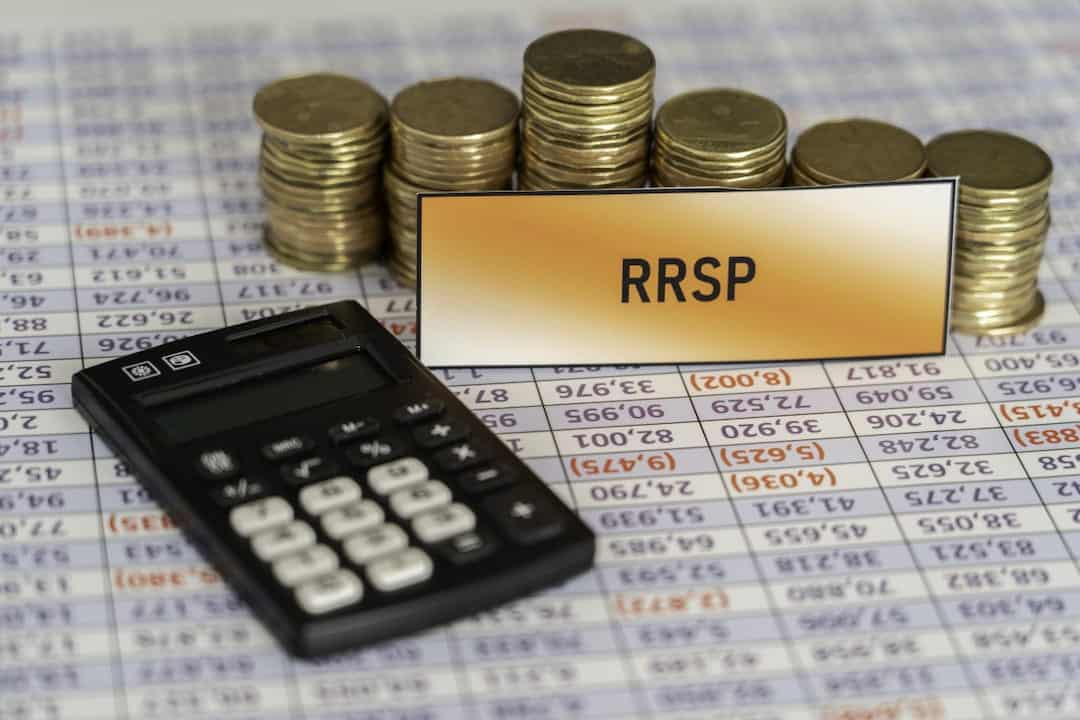 RRSP tag, a calculator and a stack of coins