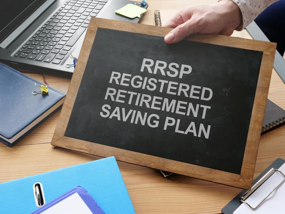 a hand holding a table with RRSP