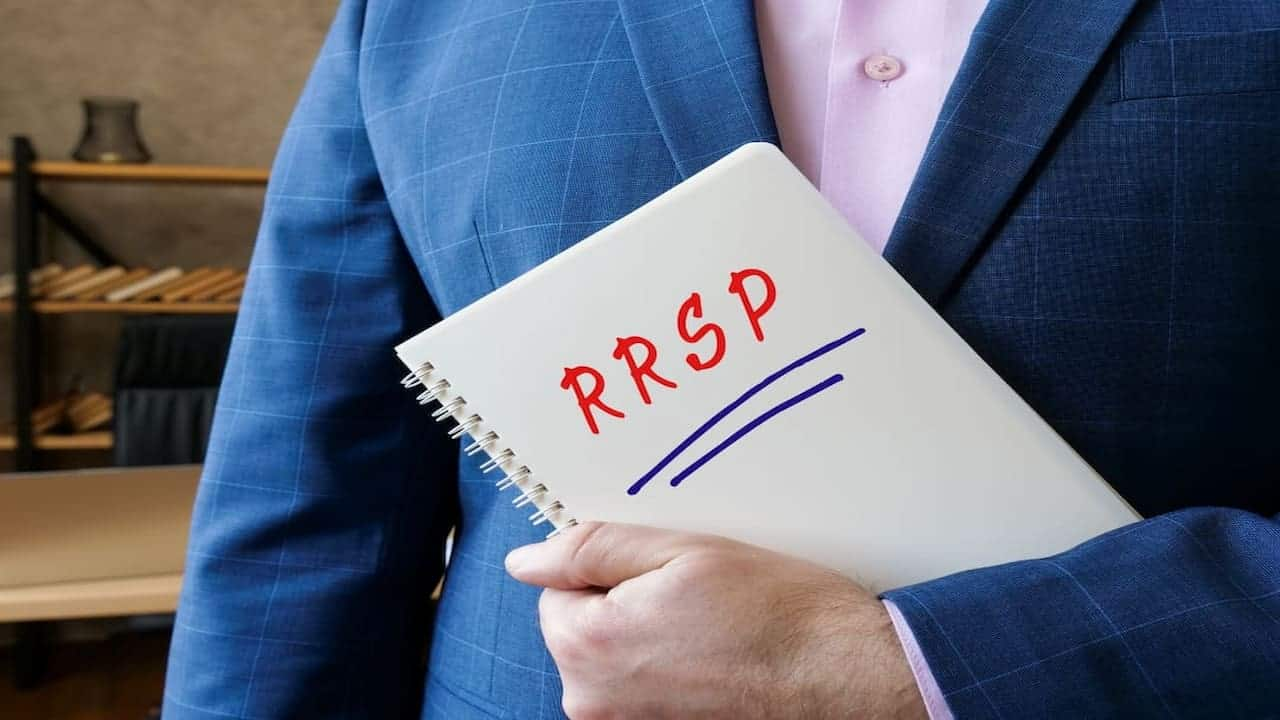 a person holding a notebook with RRSP note