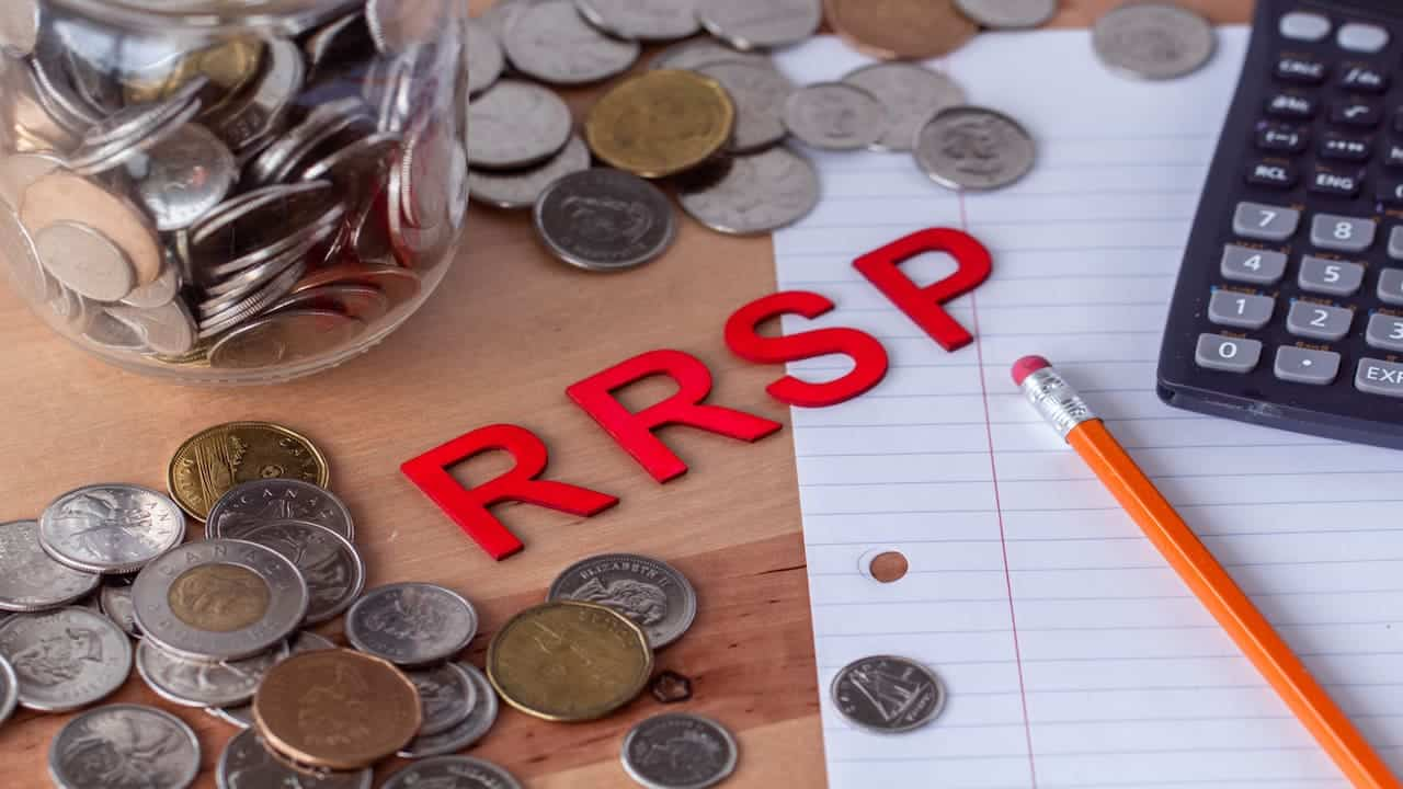 RRSP plan and coins on the table