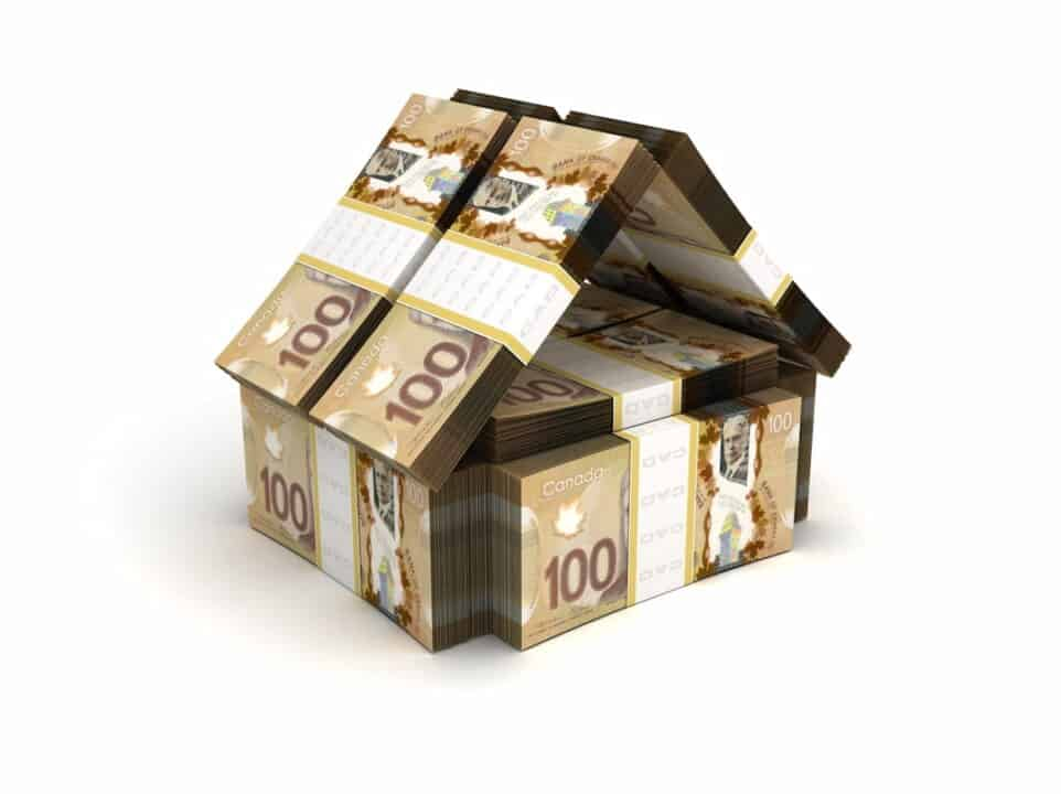 a house model made of Canadian dollars
