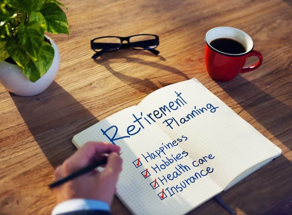 a person writing down notes about retirement