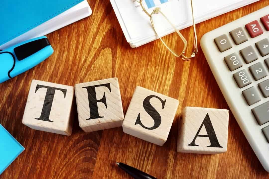 TFSA letters among calculator, glasses and documents on the table