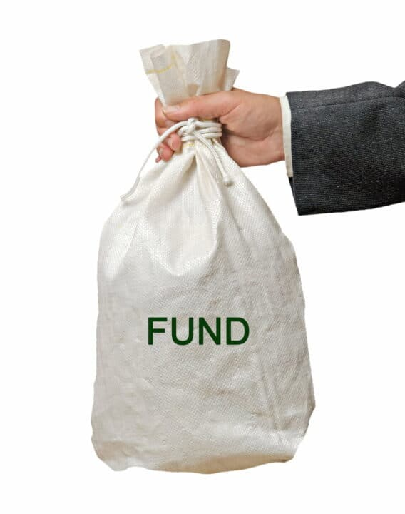 a hand holding the white fund bag
