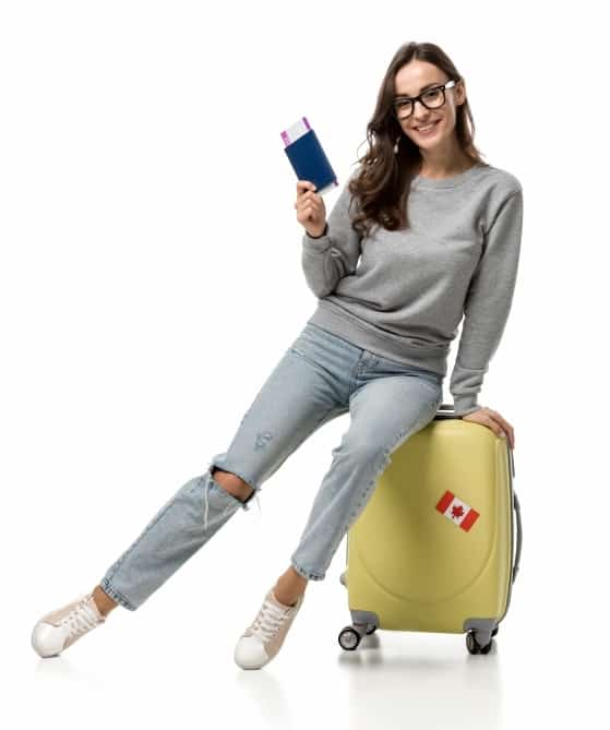 young woman with suitcase and an airplane ticket in her hand