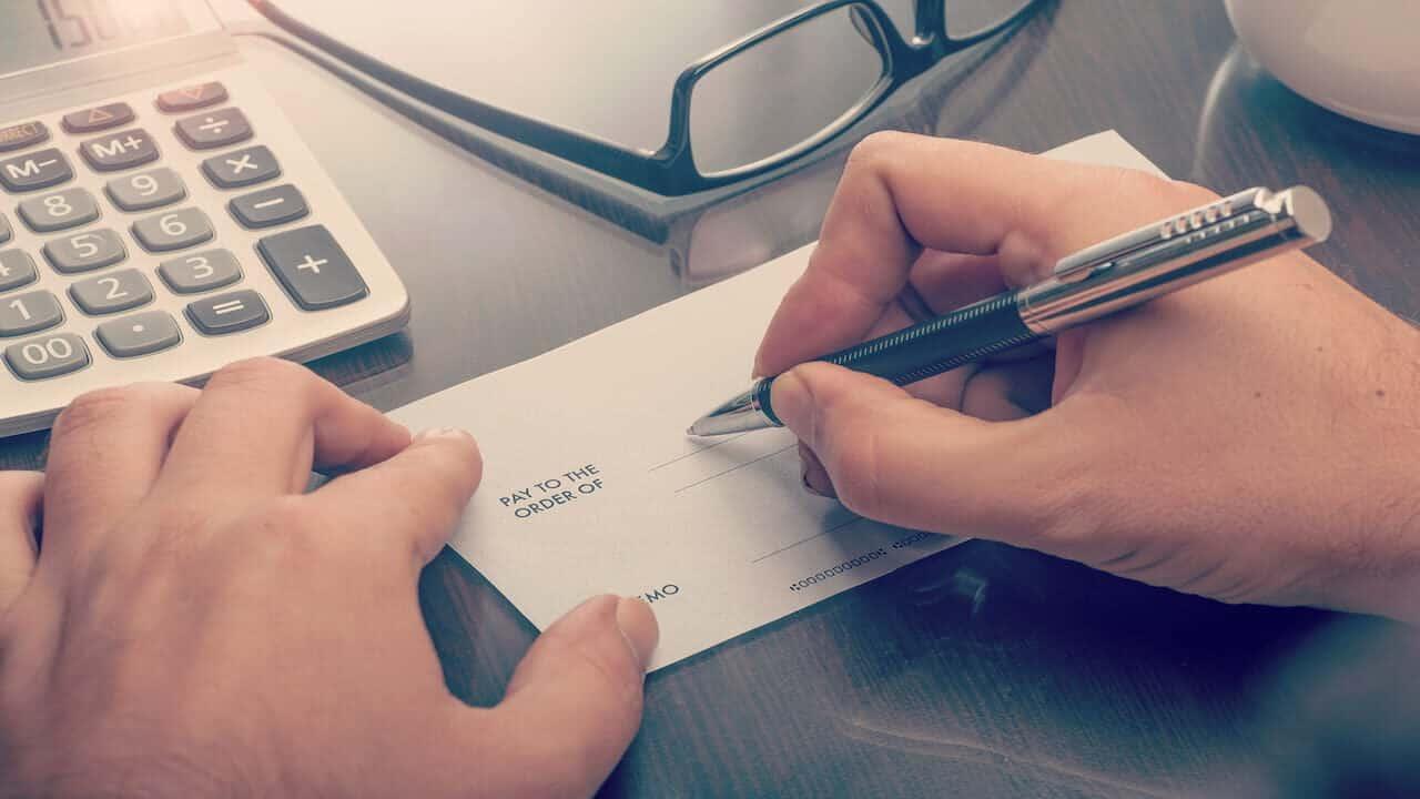 a man writing a cheque
