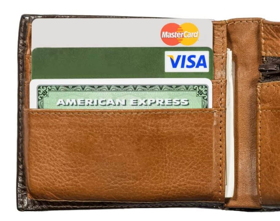 credit cards sorted in a brown leather wallet