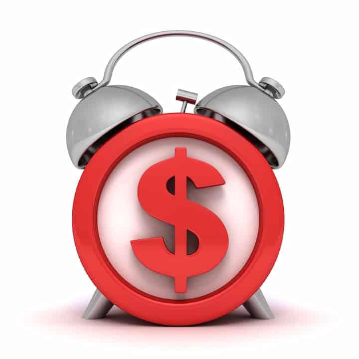 Red alarm clock with dollar