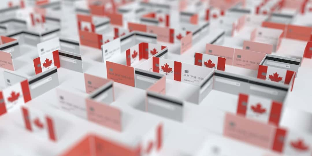 office boxes construction model made of credit cards with Canadian flag