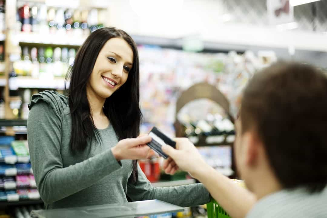 a woman in the store paying with credit card