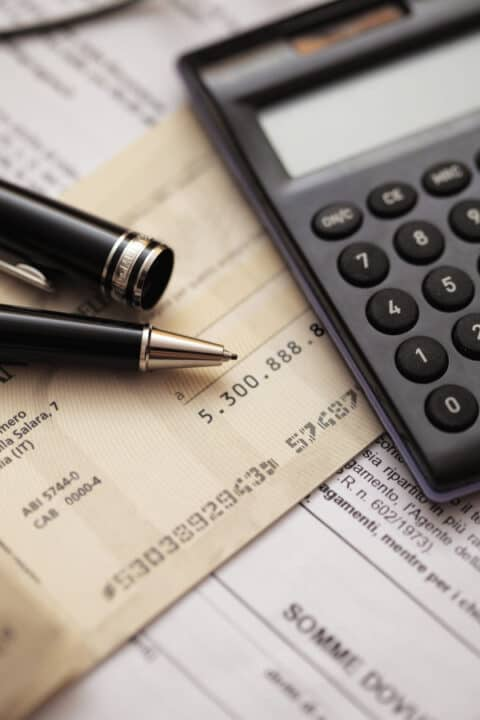 cheques, calculator and pen