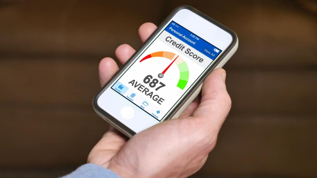 checking credit score on smartphone