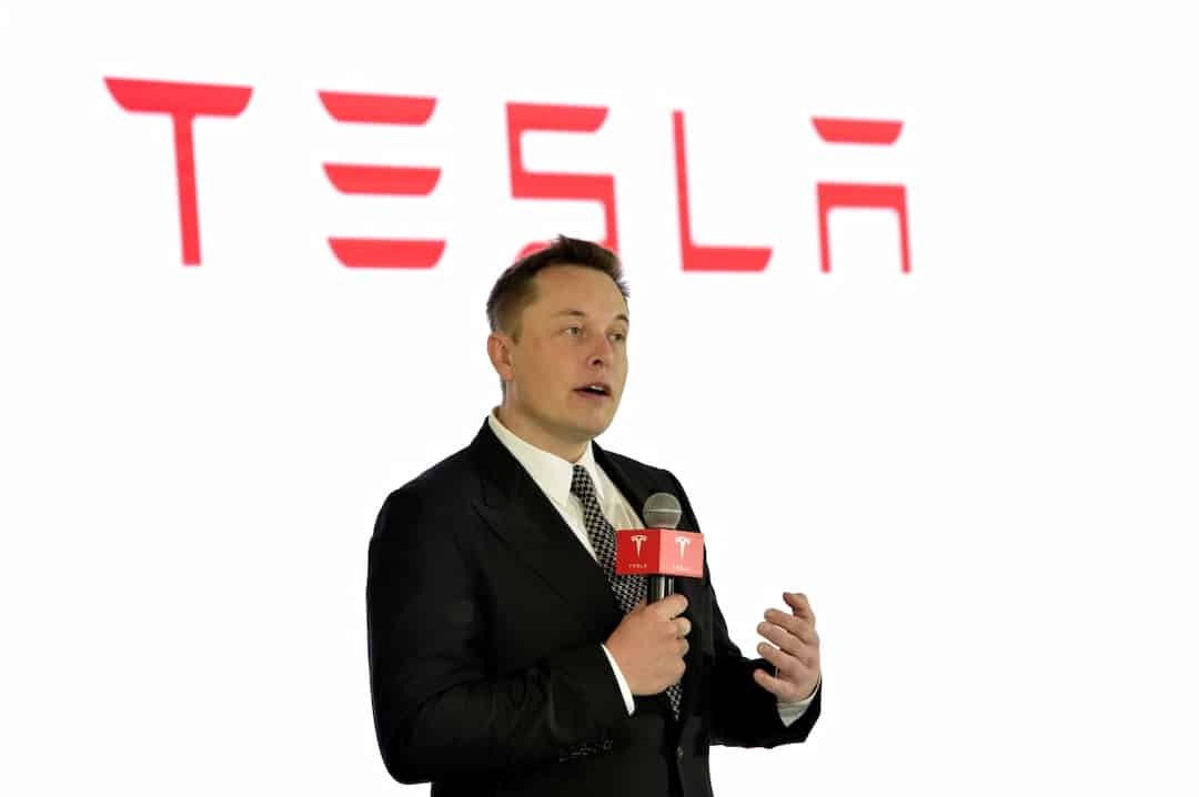 Elon Musk speaking on a press conference
