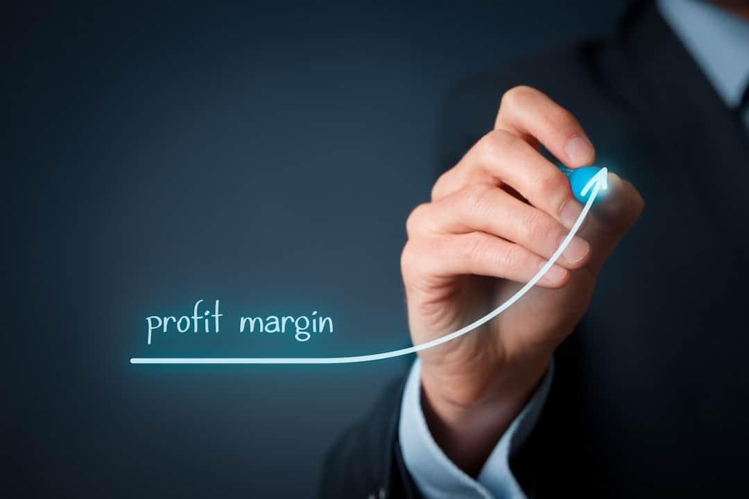 a person drawing Increase profit margin concept