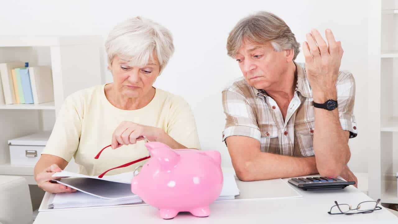 two persons planning their saving