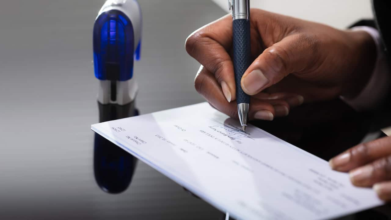 a person signing the cheque