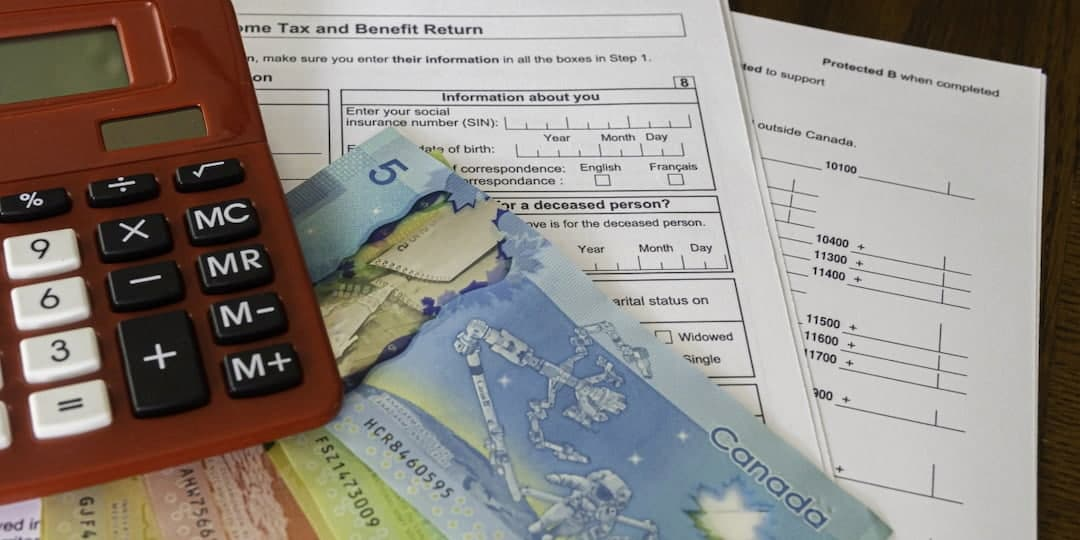 tax forms, red calculator and cash